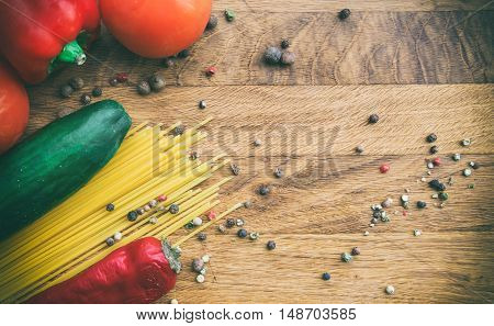 vegetables, pasta and black pepper are all on the chopping board