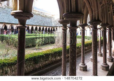 Mont Saint Michel France - September 8 2016: Cloister garden in Mont Saint Michel abbey in France