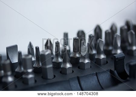 Tool set with different nozzles macro on gray concrete background
