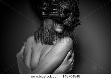 sensual alien woman naked helmeted skull and metal forks