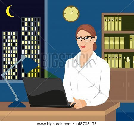 Girl working late on her laptop Pretty woman surfing the internet, or perhaps working late with . Moonlit city scene can be seen in background through the window.