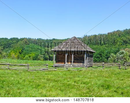Building in traditional ukrainian style on a green meadow