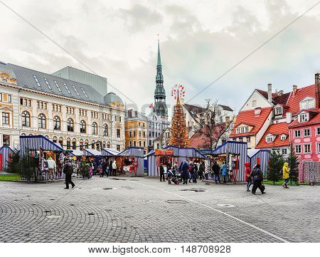 People At Riga Christmas Market With St Peter Church Steeple