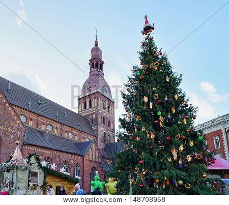 People Near Christmas Tree On Christmas Market In Riga