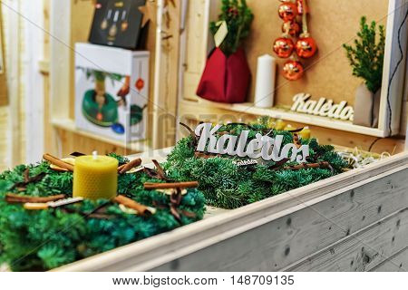 Stall With Christmas Wreath At Christmas Market In Vilnius