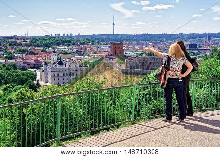 Women View Gediminas Tower And The Lower Castle In Vilnius