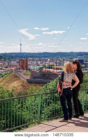 Women Viewing Gediminas Tower And The Lower Castle Vilnius
