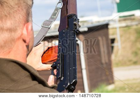 a man loads his weapon on a shooting range