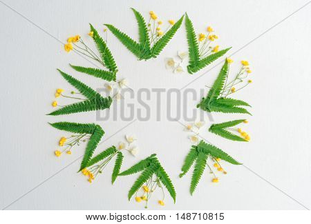 Wreath Of Jasmine Ranunculus And Leaves Of Green Fern