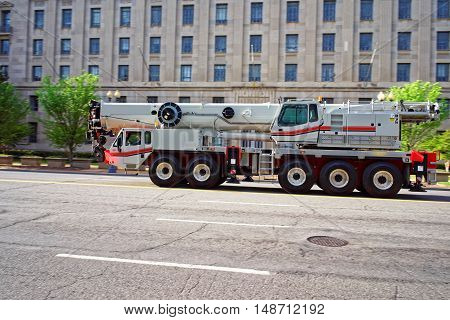 Washington DC USA - May 2 2015: It was seen driving the crane truck across the Washington D.C. streets. It was photographed on the one of the main avenues of the city.