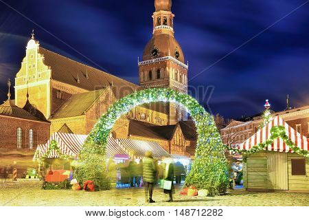 Entrance to the Christmas tree in Riga Latvia. It is located at the Dome square in the center of the old town near the Riga Cathedral. Christmas market. Motion Blur. Selective focus