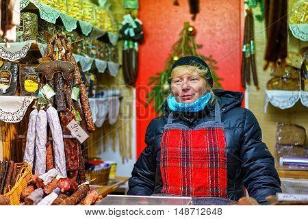 Latvian Woman Selling Traditional Goods At Riga Christmas Market