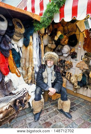 Man Dressed In Fur Clothes At Riga Christmas Market