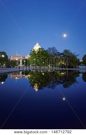 Night view at the beautiful pond with the US Capitol in the background. It is located on a top of a Capitol Hill in Washington D.C. USA. The Capitol was built in 1800.