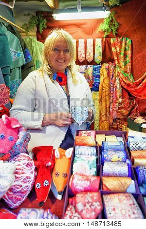 Woman Offering Festive Ties At The Riga Christmas Market