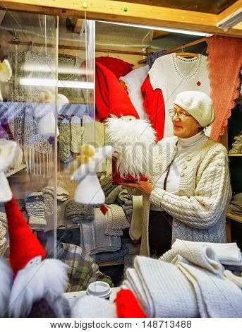 Woman Selling Angel Statues At The Riga Christmas Market