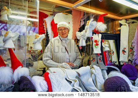 Woman Selling Woolen Clothes At Christmas Market In Riga
