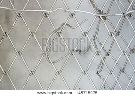 Texture of wire mesh.Steel grating fence background.Close up Metal netvintage color.Mesh fence