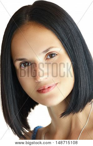 Sensual young beautiful brunette girl with make-up smiling and posing isolated on white background/Close-up beauty portrait of young caucasian woman with perfect haircut