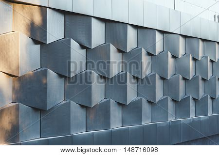 Perspective view of wall of black metal futuristic new building.