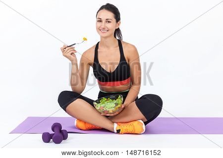 Girl Eating Salad After Training