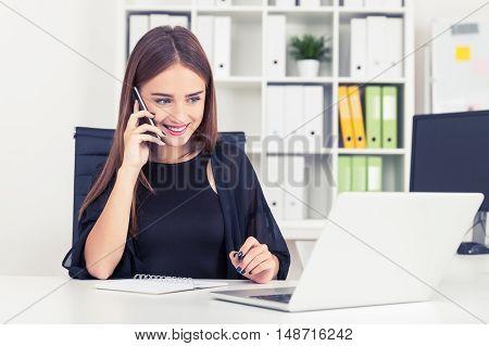 Girl In Black Is Talking On Her Phone