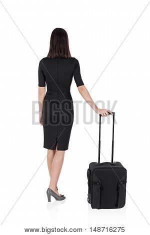 Isolated rear view of woman in business suit with suitcase standing with her back to the viewer. Concept of travelling. Mock up