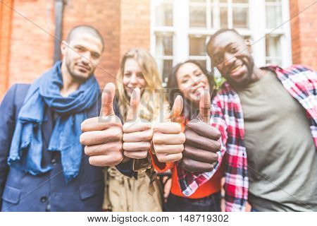 Four Persons With Different Ethnicities Showing Thumbs Up