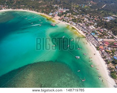 aerial view of fishing boats in the turquoise waters of the shoals of Koh Phangan