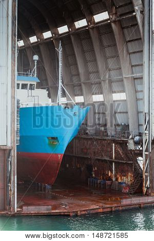 Dockyard ship for repairs in large floating dry dock