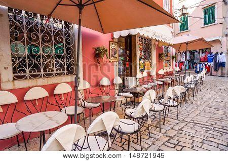 Rovinj Croatia- September 2014. Cafe on cobblestone street in Rovinj Croatia.