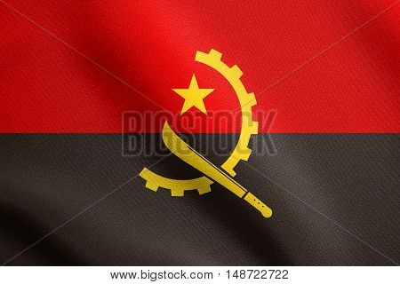 Angolan national official flag. African patriotic symbol banner element background. Flag of Angola waving in the wind with detailed fabric texture, illustration