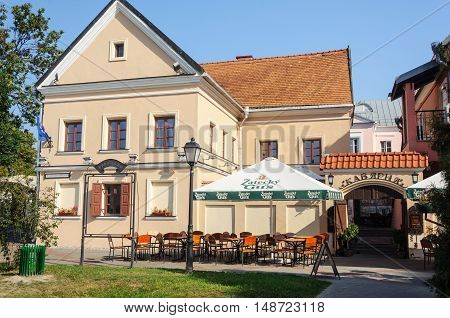 Minsk, Belarus - September 12, 2016: Empty small open-air cafe in Trinity Suburb, old part of Minsk