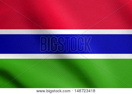 Gambian national official flag. African patriotic symbol banner element background. Flag of the Gambia waving in the wind with detailed fabric texture, illustration