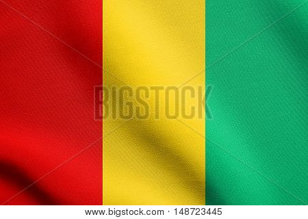 Guinean national official flag. African patriotic symbol banner element background. Flag of Guinea waving in the wind with detailed fabric texture, illustration