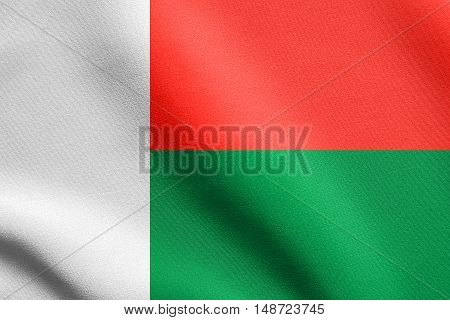 Madagascar national official flag. African patriotic symbol banner element background. Flag of Madagascar waving in the wind with detailed fabric texture, illustration