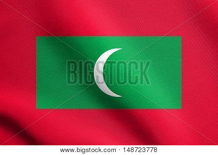 Maldivian national symbol. Patriotic background design. Flag of Maldives waving in the wind with detailed fabric texture, illustration