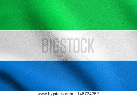 Sierra Leonean national official flag. African patriotic symbol banner element background. Flag of Sierra Leone waving in the wind with detailed fabric texture, illustration