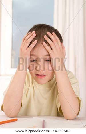 Upset  Boy With A Pencil Sitting