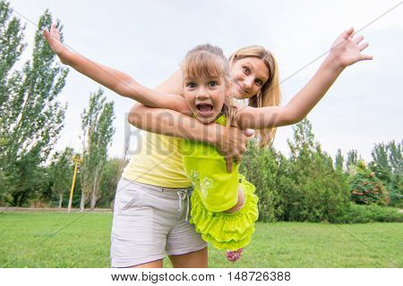 Mom keeps daughter in her arms and rocking