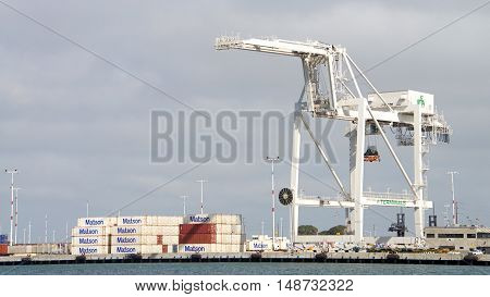 Oakland CA - September 12 2016: Super Post Panamax cranes at the Port of Oakland. The giant cranes at the apex are roughly the height of a 24 story building and can weigh 1600 to 2000 tons each.