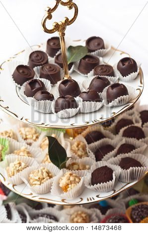 A Plate Of Chocolates With Other Treats