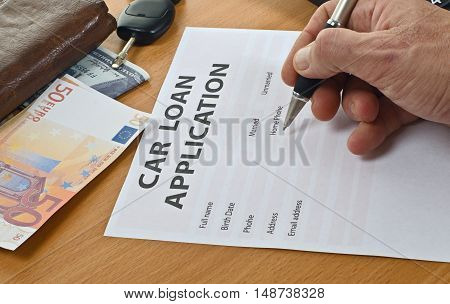 Form Car Loan Application Is On The Table