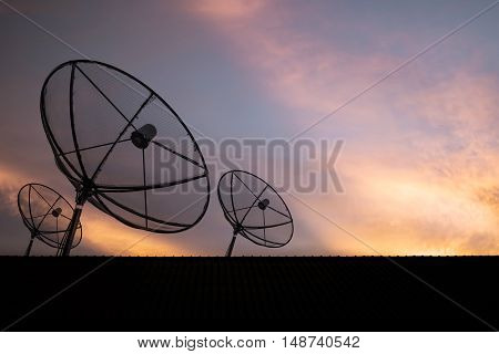 Silhouette, Satellite dish on roof with sky sunset, communication technology network image background
