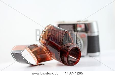 picture of a vintage camera film roll on white background