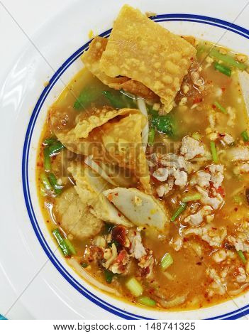 Top View Noodles In Thai Spicy Tom Yum Soup With Pork Street Food Style