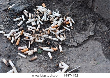Pile Of Cigarettes On Ground