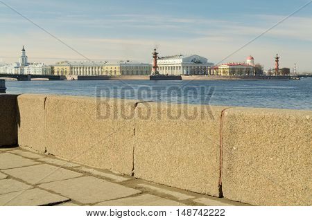 Urban landscape with a granite embankment on the river.