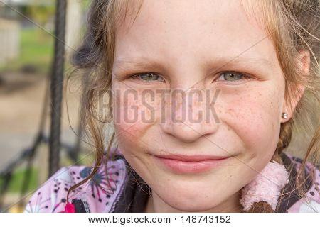 outdoor portrait of young happy girl