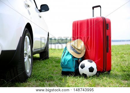 Luggage and accessories near car. Travel concept
